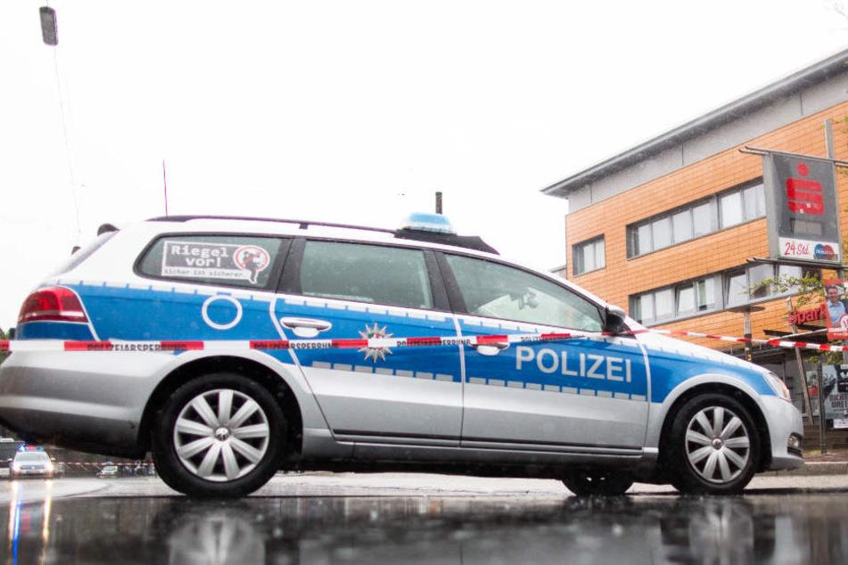 Die Polizei konnte den Bankräuber nach der gescheiterten Tat schnell erwischen. (Symbolbild)
