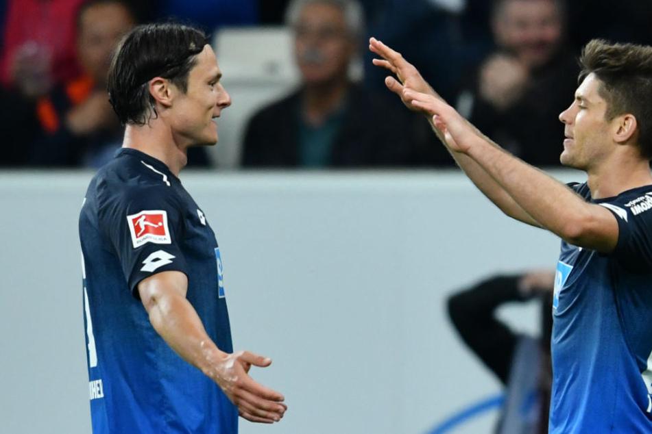 Nico Schulz (l.) jubelt mit TSG-Hoffenheim-Kollege Andrej Kramaric (27).
