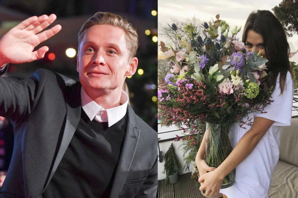Verliebte Turteltauben: Matthias Schweighöfer schenkt seiner Freundin Blumen.