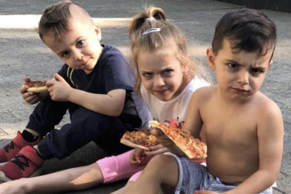 Dijbraul, Aaliyah und Issa werden beim Pizzaessen von ihrem Papa gestört.