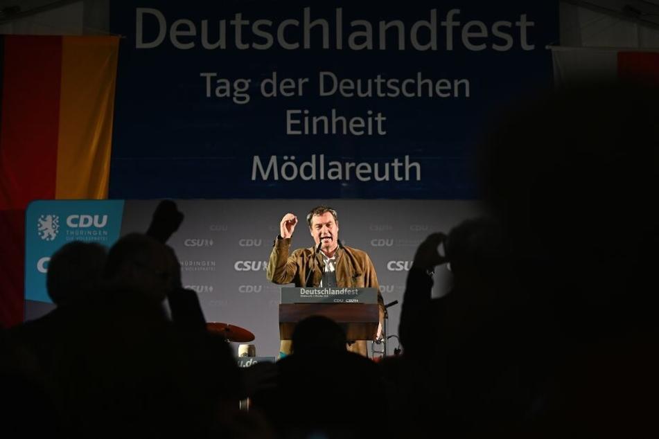 Der Bayerische Ministerpräsident Markus Söder (CSU) hält bei der Feier zum Tag der Deutschen Einheit in Mödlareuth eine Rede.