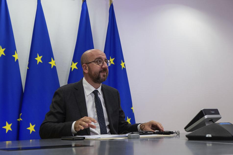 Charles Michel, Präsident des Europäischen Rates, spricht während einer Videokonferenz mit Bundeskanzlerin Merkel.