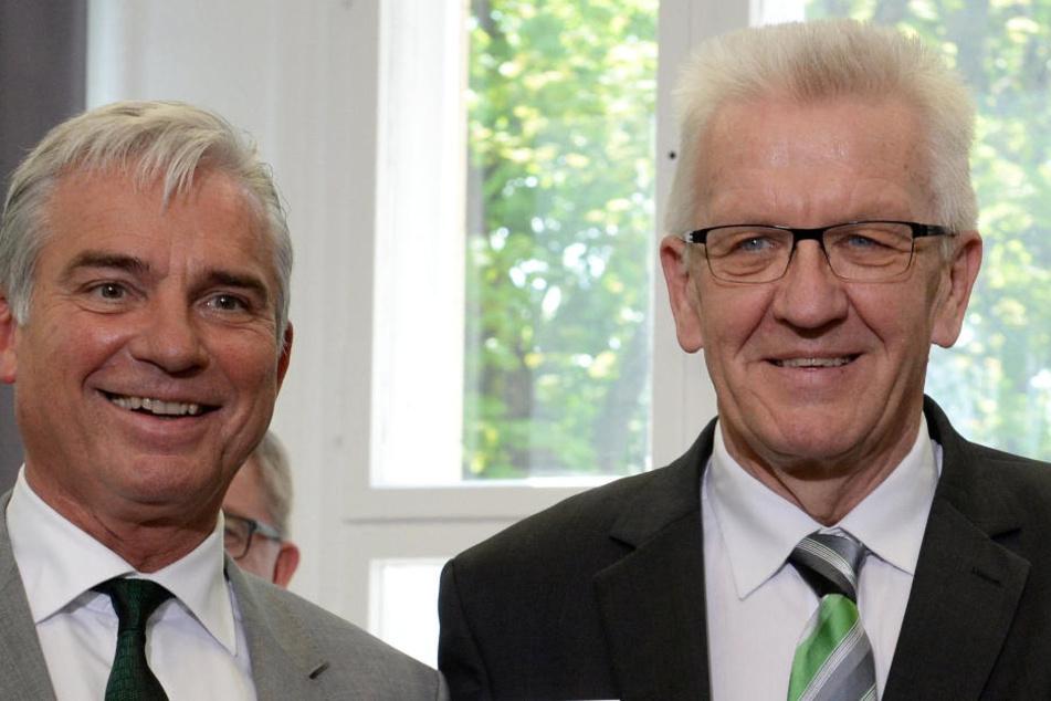 CDU-Landeschef Thomas Strobl (l) und der Grüne Ministerpräsident Winfried Kretschmann (r.) streiten sich ums Bleiberecht für abgelehnte Asylbewerber.