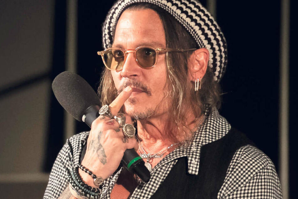 Johnny Depp (55).
