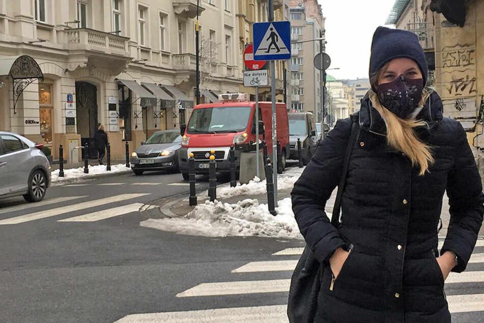Eine junge Frau mit einer Smogmaske in Warschau. Immer mehr Polen sind sich über die gefährliche Luftverschmutzung in ihrem Land im Klaren.