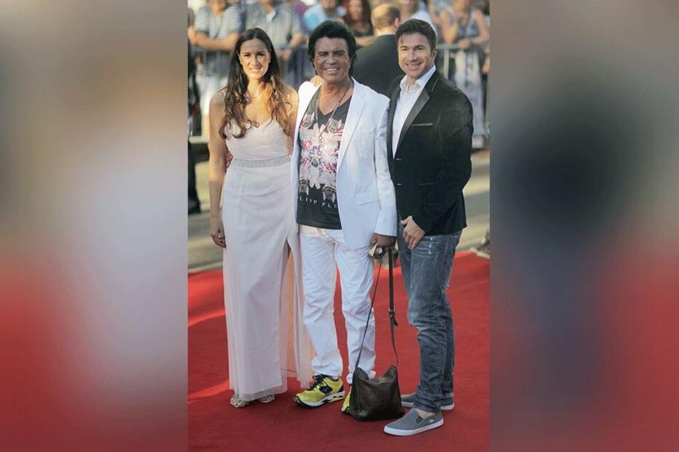 """Costa Cordalis mit seinen Kindern Angeliki, genannt """"Kiki"""", und Sohn Lucas bei der Premiere der Nibelungen-Festspiele 2014 in Worms."""