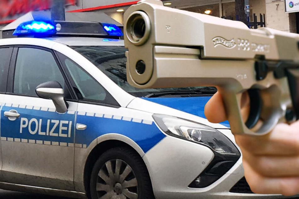 Die Polizei fahndet nach einem bewaffneten Mann mit Pistole (Symbolbild).