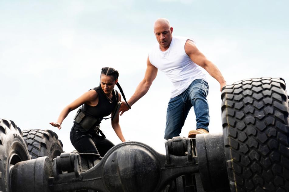 """April 2021, statt Mai 2020: Der Start von """"Fast & Furious 9"""" um Dominic """"Dom"""" Toretto (r., Vin Diesel) und Ramsey (Nathalie Emmanuel) wurde um fast ein Jahr nach hinten verschoben."""