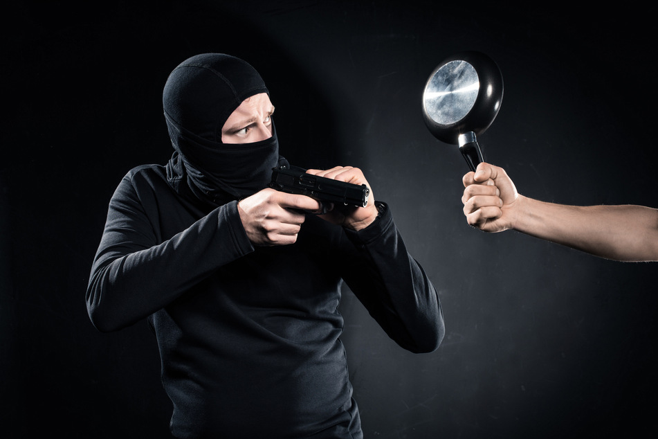 A robber with a toy gun is no match for a brave soul with a frying pan (stock image).