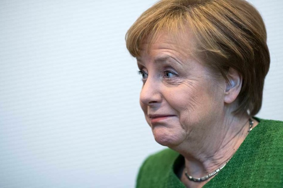Angela Merkel wurde nach ihrer Wahl von einem Störer attackiert.