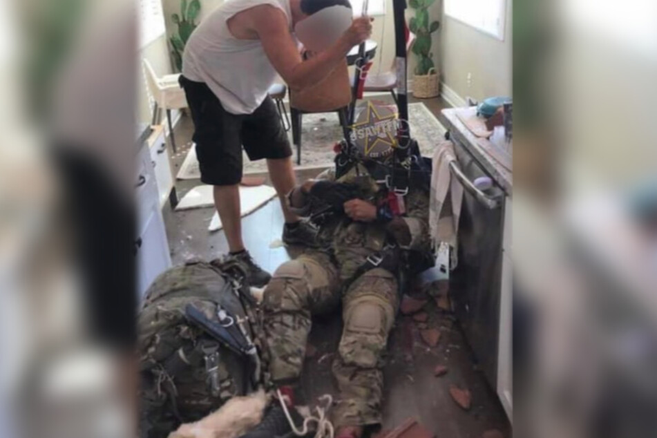 """The soldier """"landed"""" on the kitchen floor of the house, and seemed to have some injuries to his feet."""