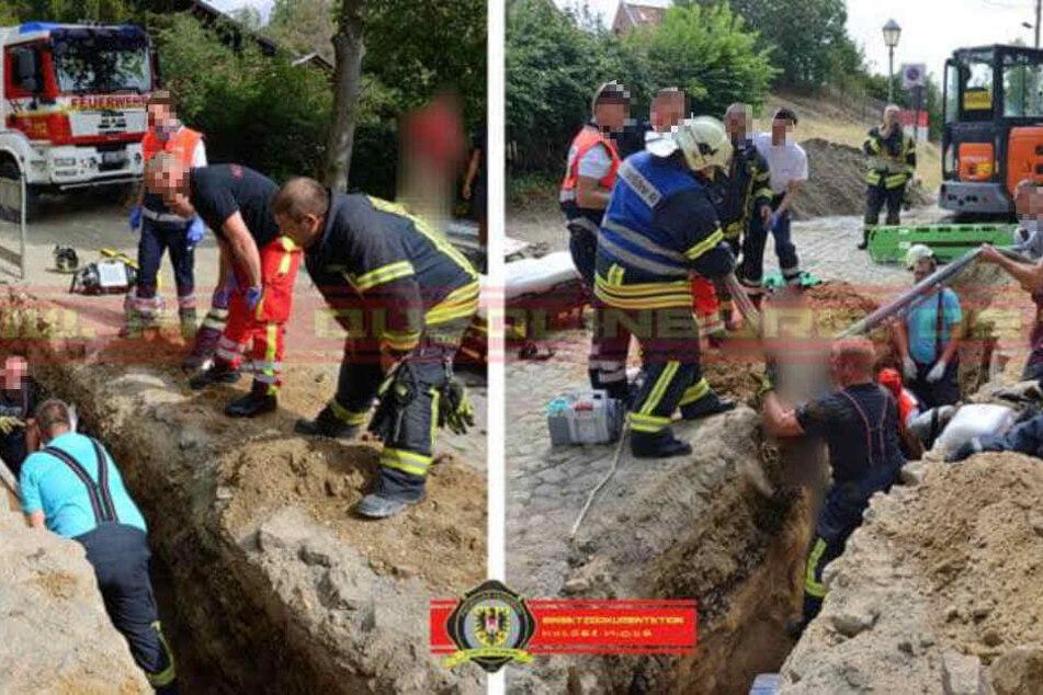 Mit bloßen Händen wurde der Bauarbeiter von zwei Feuerwehrleuten ausgegraben.