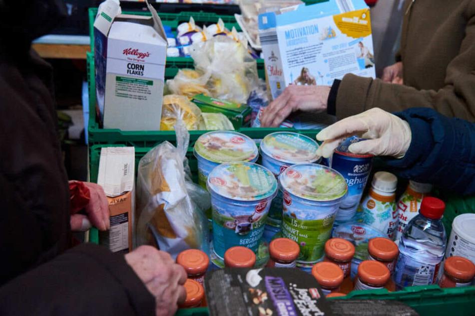 Die Berliner Tafel verteilt seit 1993 Lebensmittelspenden an bedürftige Menschen.