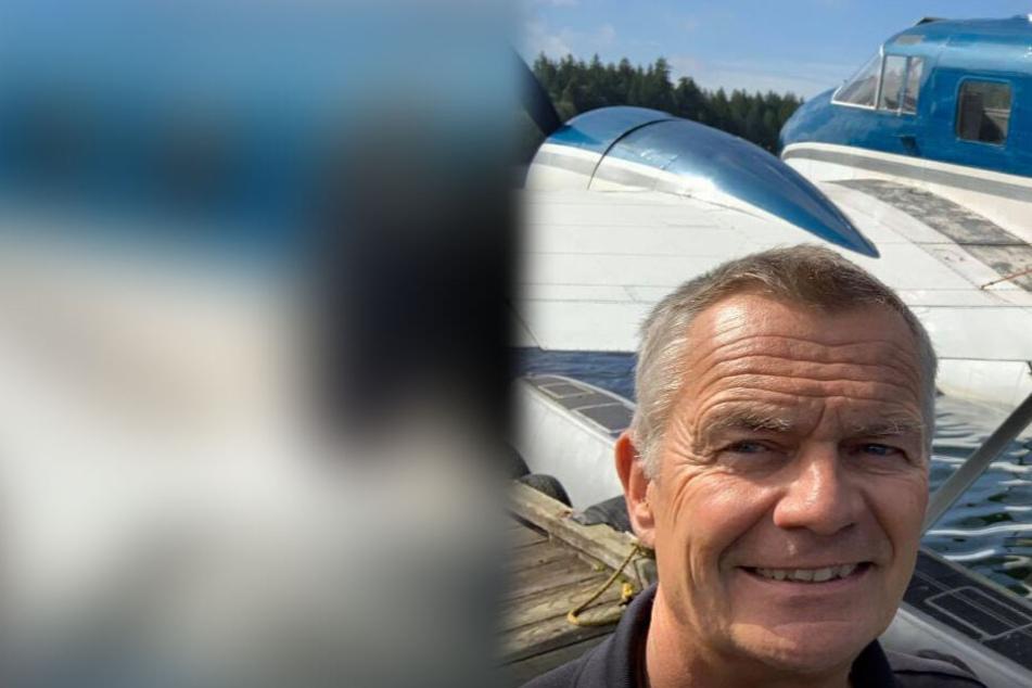 Alex Bahlsen (61) vor einem Flugzeug.