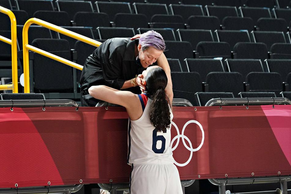 Megan Rapinoe congratulates her fiancee Sue Bird after the women's basketball final on Sunday.