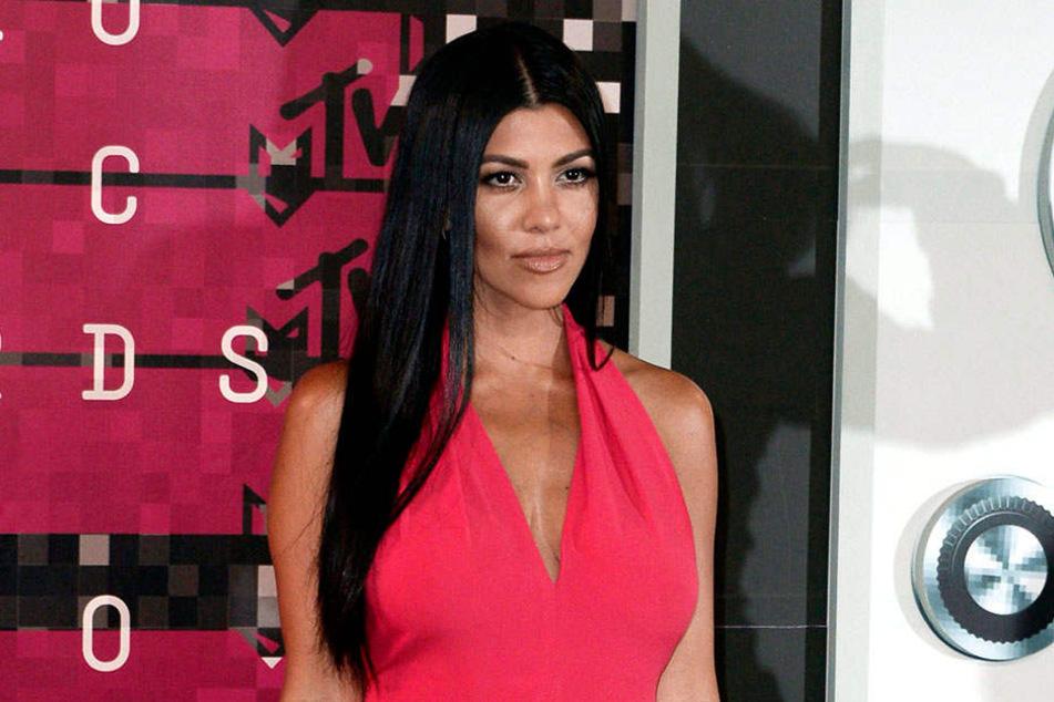 Kourtney Kardashian (39)