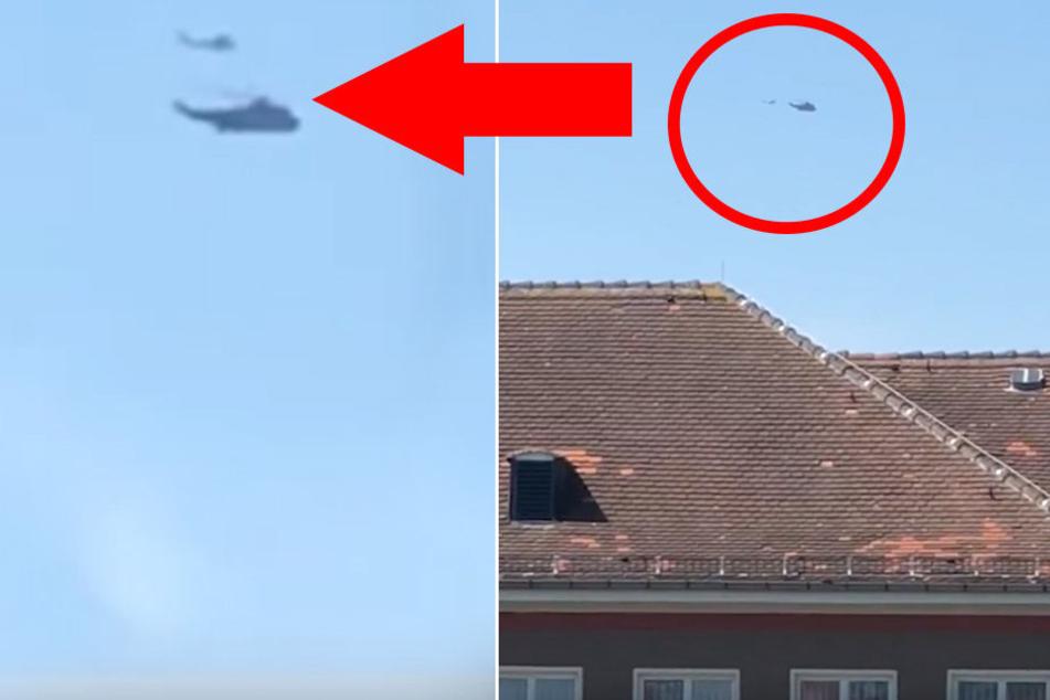Hier fliegen ein Militär-Heli und ein Kleinflugzeug eng an eng über Dresden.