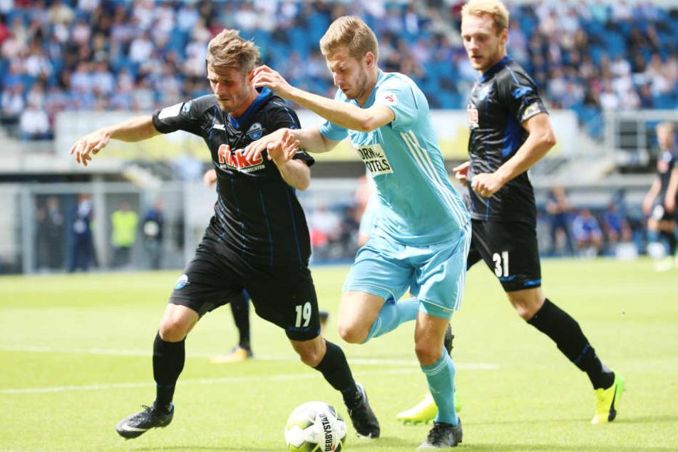 Marc Vucinovic (l., Paderborn) gegen Marcus Mlynikowski (Chemnitz).