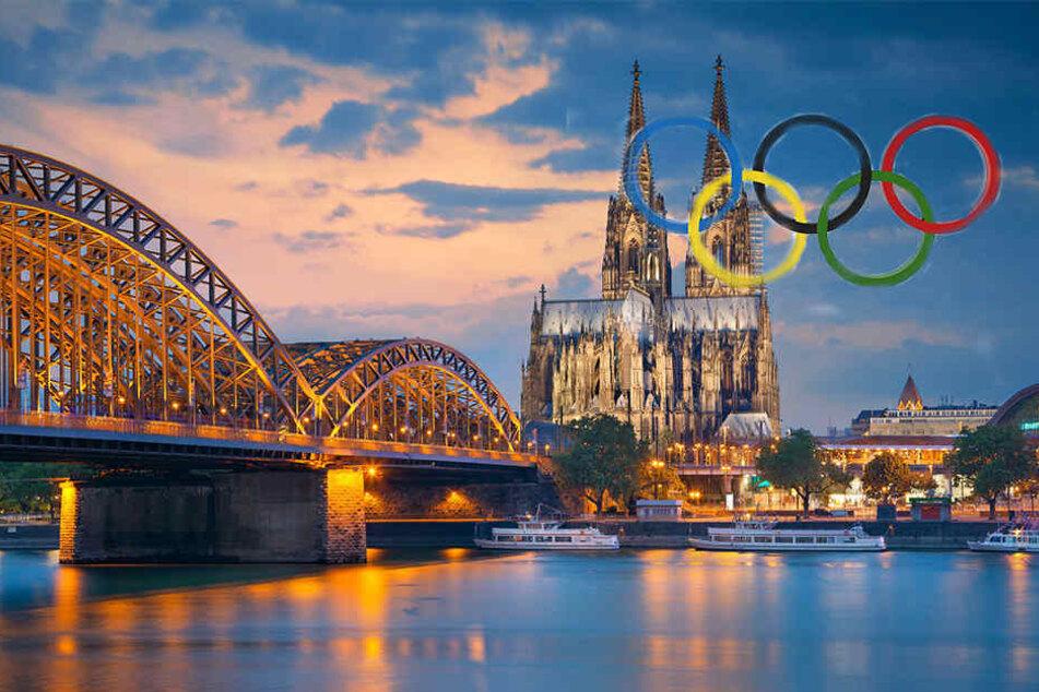 Noch sind die Olympischen Ringe über Köln nur eine Fotomontage. Doch 2032 könnten sie wirklich über Köln hängen.