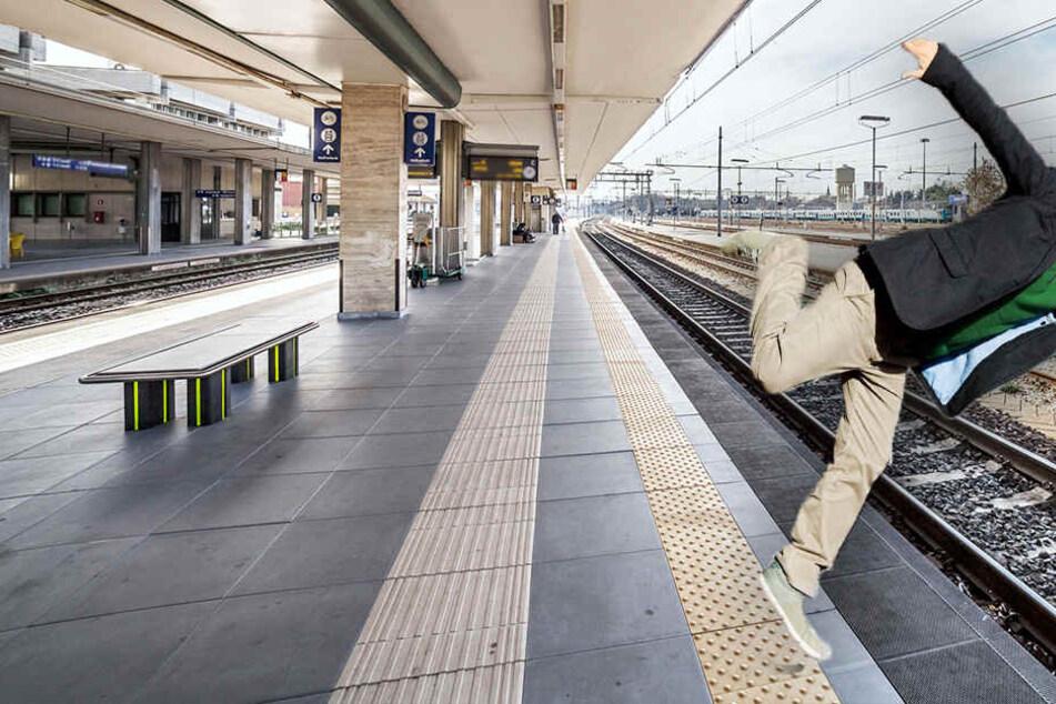 Der Mann konnte sich nicht mehr selbst aus dem Gleisbett befreien. (Bildmontage)