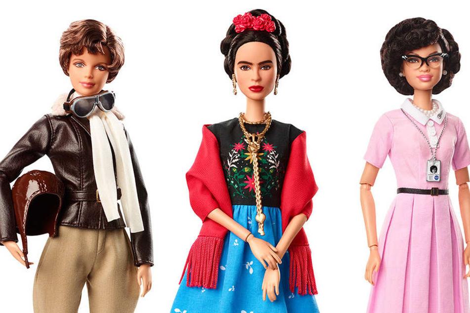 Barbie-Puppen von Mattel, die der Flugpionierin Amelia Earhart, Malerin Frida Kahlo und Mathematikerin Katherine Johnson (v.li.) nachempfunden sind.