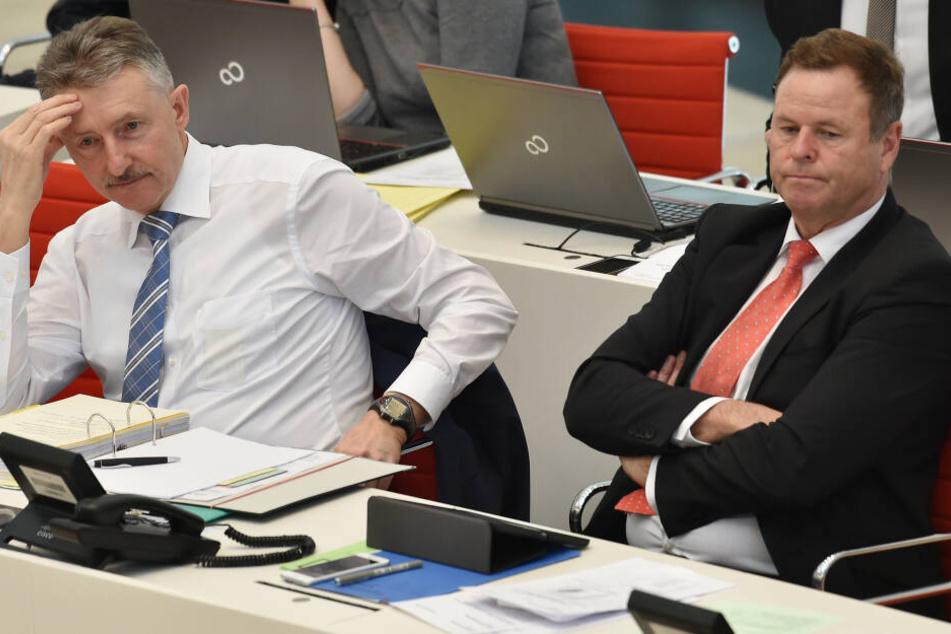 Unterschiedlicher Meinung? Karl-Heinz Schröter (l., SPD) und Christian Görke (r., Linke) entscheiden heute über das umstrittene Polizeigesetze.