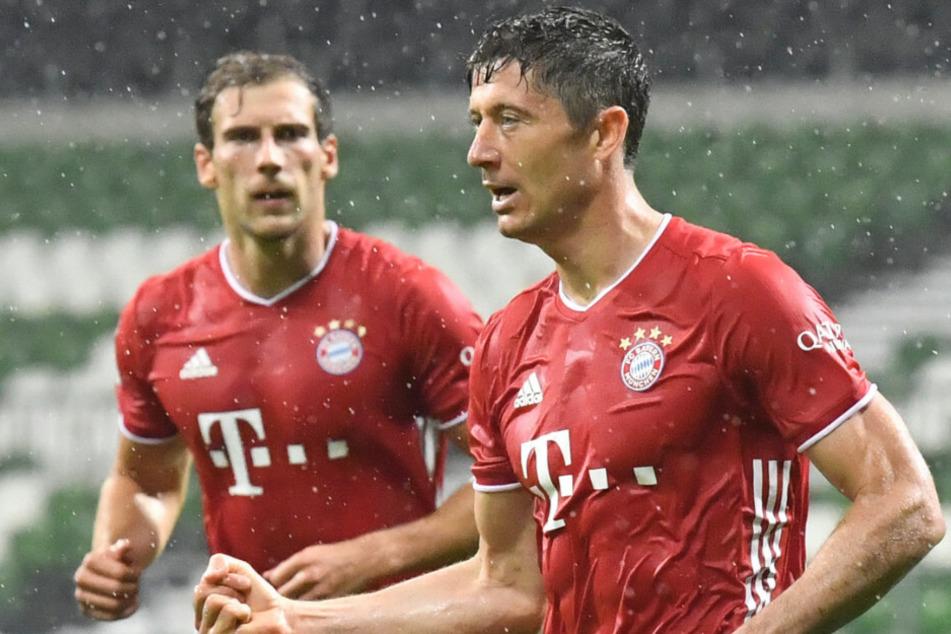 Robert Lewandowski (r.) und der FC Bayern sind Meister.