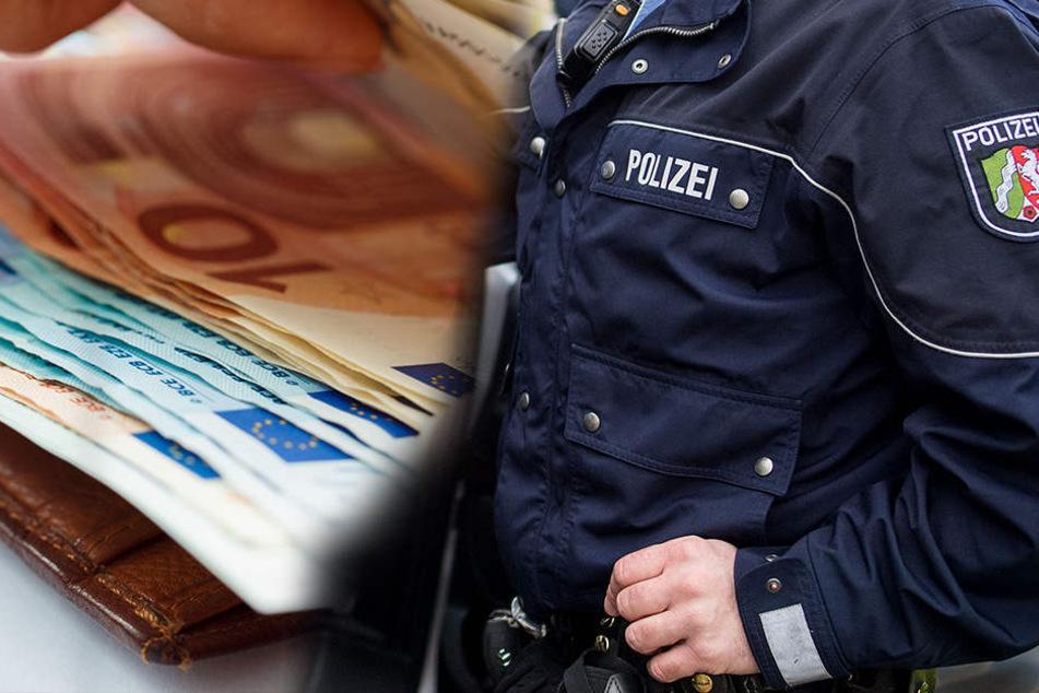 Der Mann in Düsseldorf wurde von falschen Polizisten um 700 Euro gebracht.