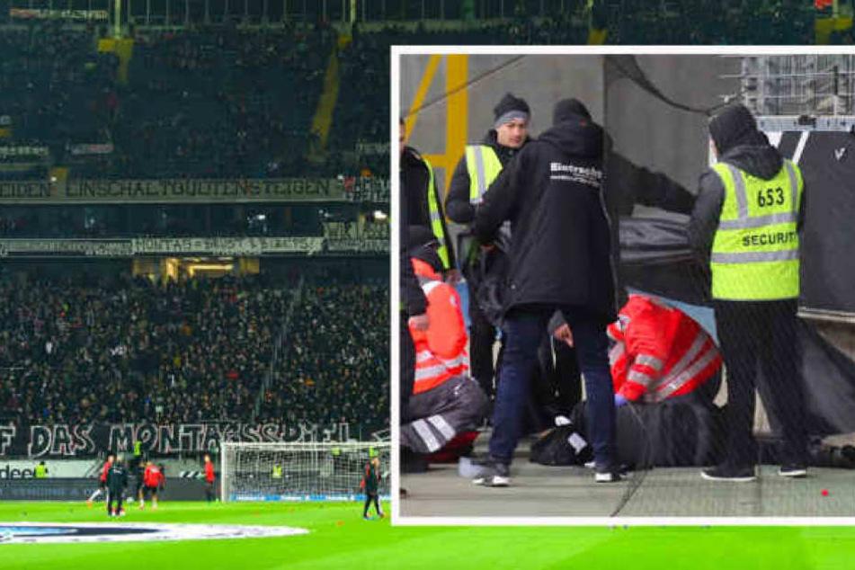 Während es dem gegen Leipzig vom Zaun gestürzten Fan besser geht, läuft die Eintracht zu Ehren des verstorbenen Anhängers mit Trauerflor auf.