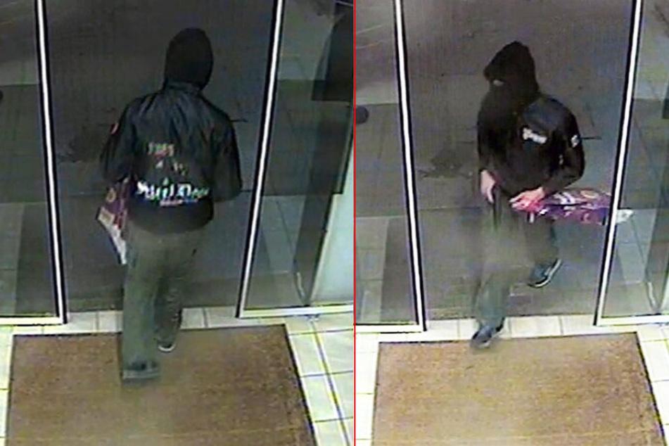 Die Polizei sucht diesen Maskierten: Er soll eine Tankstelle in Putzkau überfallen haben.