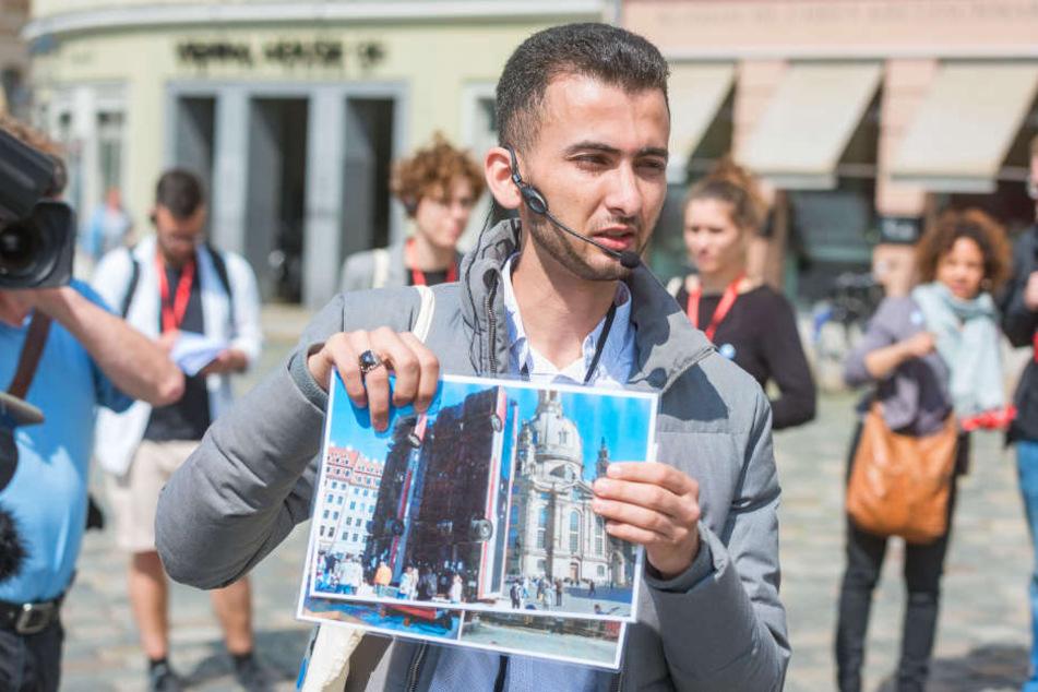 """Flüchtling und Neu-Dresdner Mohammad Nhar (26) führte am Mittwoch durch die Altstadt, verknüpfte die Stationen mit Erzählungen aus seiner syrischen Heimat, ging auch auf die """"Schrottbusse"""" vor der Frauenkirche ein."""
