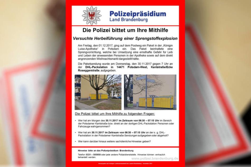 Ein Mitarbeiter der Polizei Brandenburg legt Fahndungsplakate nach einer Pressekonferenz zur Potsdamer Paketbombe Fahndungsplakate aus.