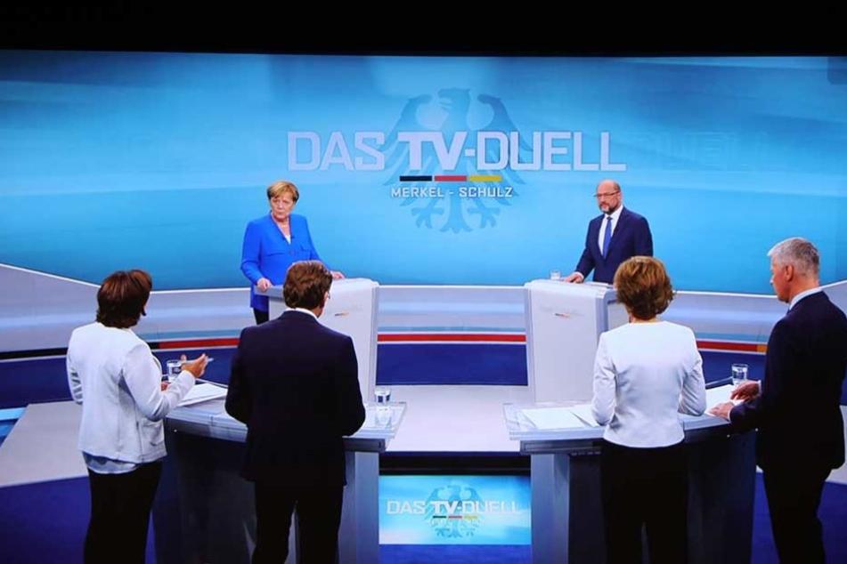 Die Fragerunde: Vier Moderatoren und die beiden Kandidaten.