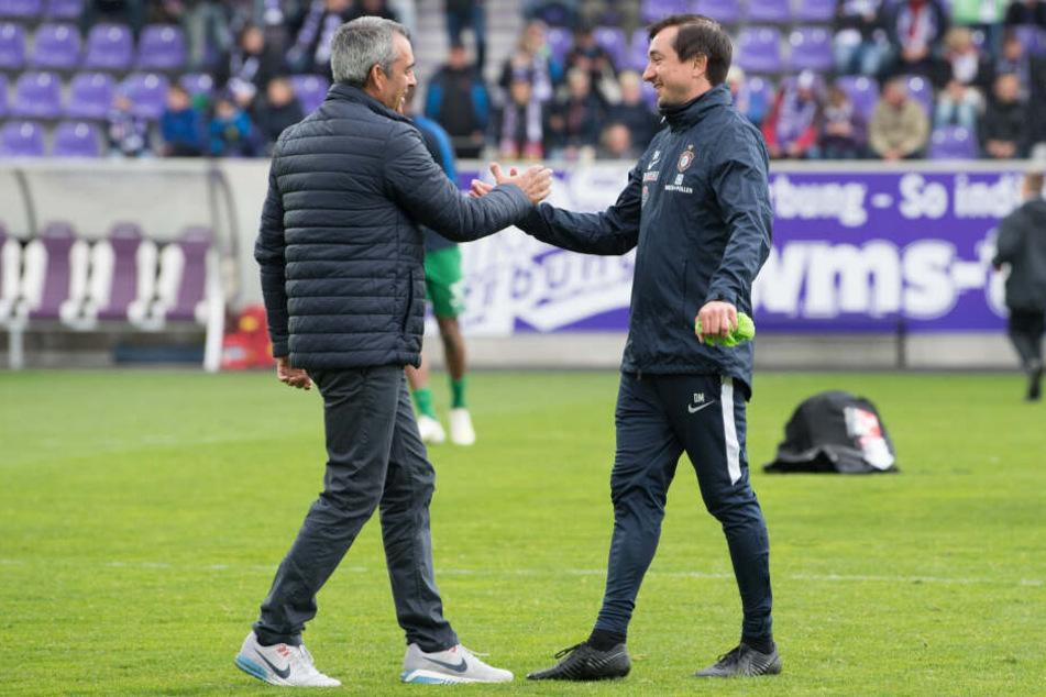 Shake hands zwischen zwei Trainern, an denen die Entlassungswelle vorübergegangen ist: Bochums Robin Dutt (l.) und Aues Daniel Meyer.
