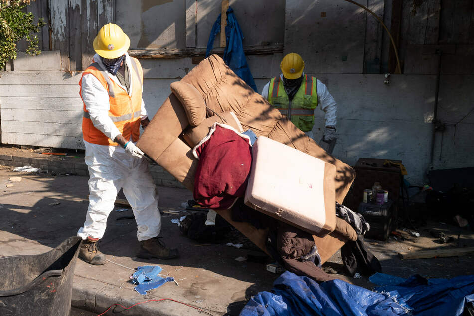 Homelessness rates are high in Los Angeles: this picture shows sanitation workers clearing out a homeless encampment in the city in August 2020.