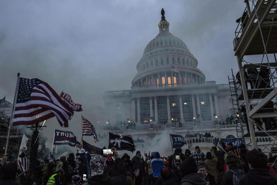 Security forces respond with tear gas after pro-Trump supporters breached the US Capitol on Wednesday.