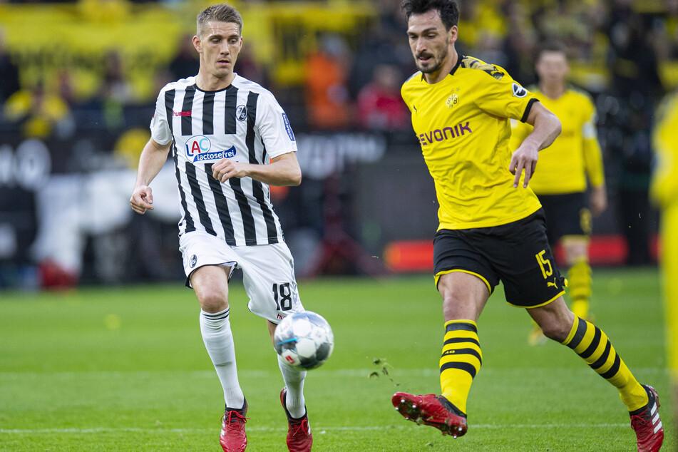 Auf dem Platz Gegner, außerhalb Verbündete: Freiburgs Nils Petersen (l.) und Dortmunds Mats Hummels.