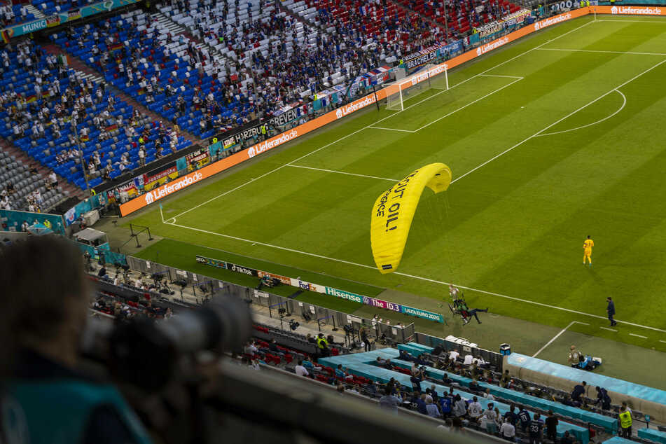 Parachuting Greenpeace protester causes panic and injuries at Euro 2020 soccer championships