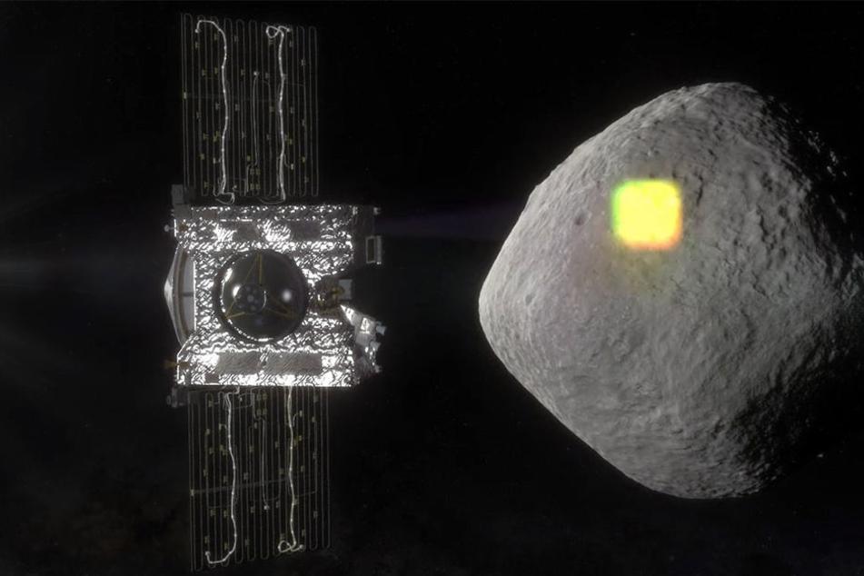 Die undatierte Illustration zeigt die Sonde Osiris Rex (l) und den erdnahen Asteroiden Bennu.