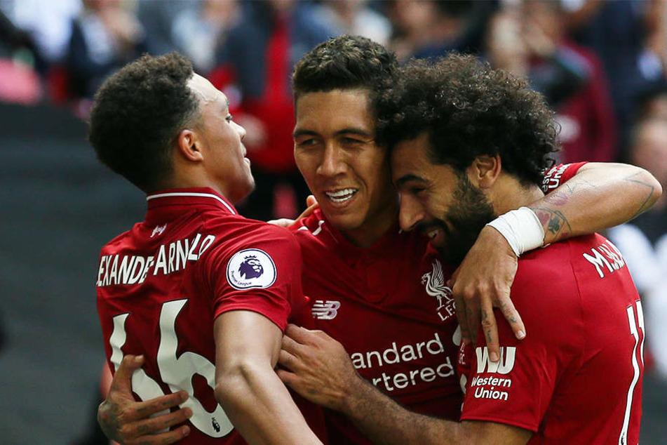 Liverpools Trent Alexander-Arnold (l.), der Ex-Hoffenheimer Roberto Firmino (M.) und Mohamed Salah (r.) eilen von Sieg zu Sieg.