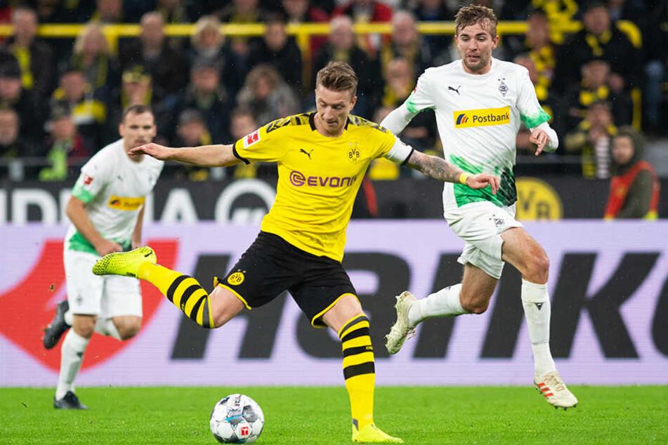 Obwohl Borussia Mönchengladbach bei Borussia Dortmund verlor, stehen die Fohlen weiter an der Tabellenspitze.