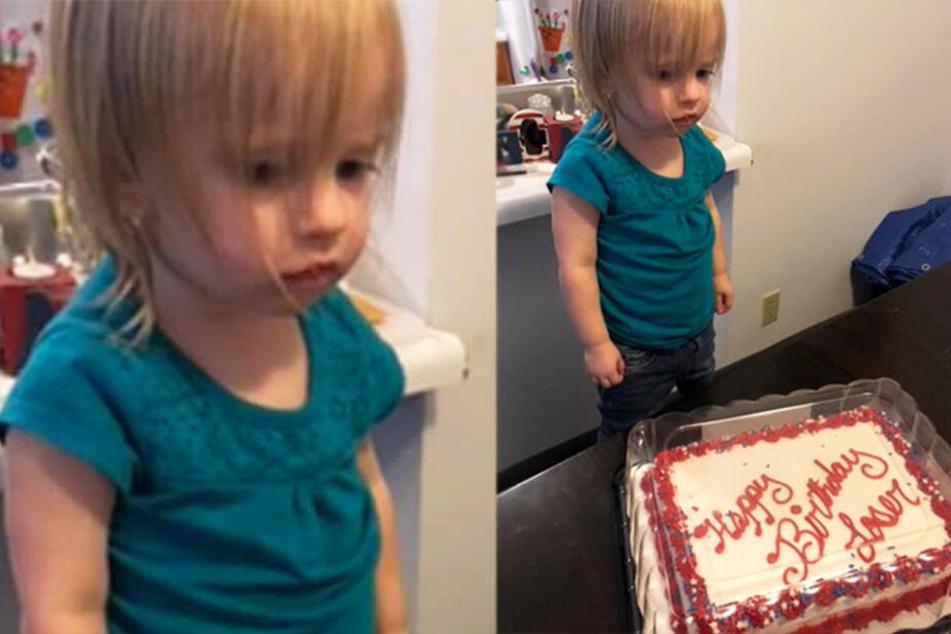 Der Blick wirkt so, als wüsste die kleine Elizabeth ganz genau, was auf ihrem Kuchen steht...