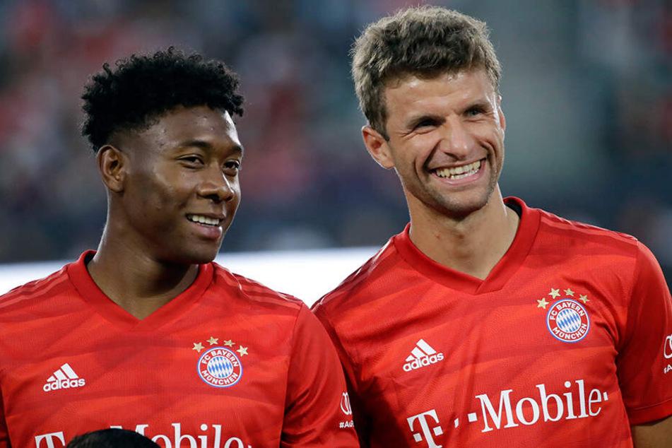 David Alaba und sein Teamkollege Thomas Müller.