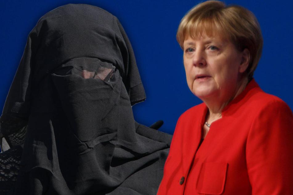 Unter heftigem Applaus der CDU: Merkel will Burka-Verbot
