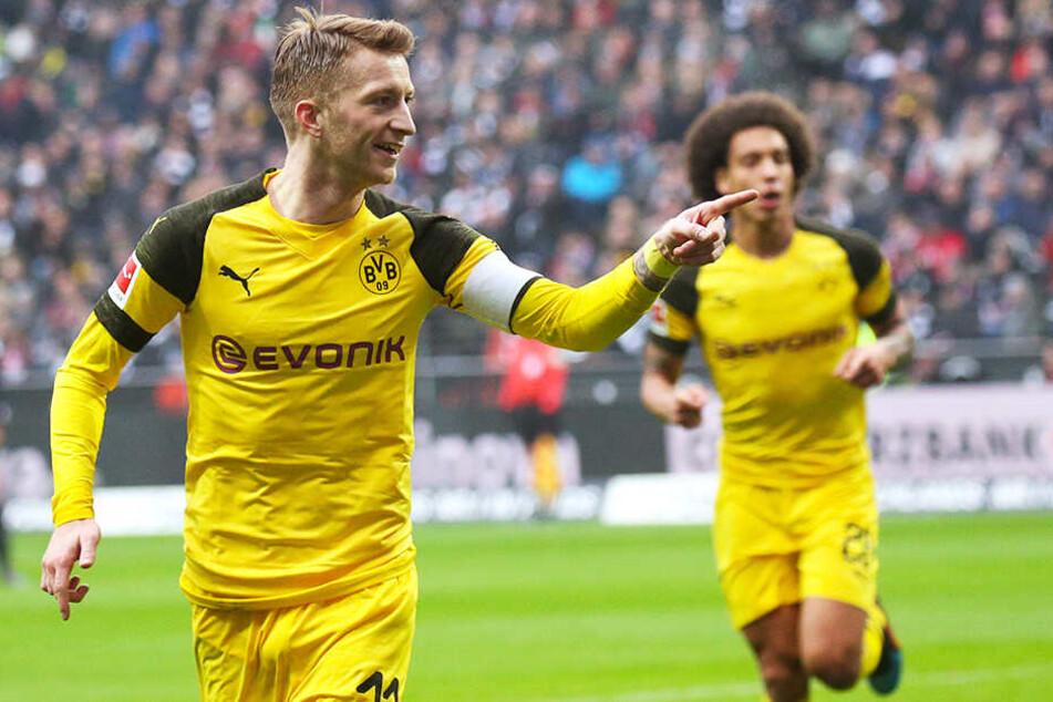 BVB-Kapitän Marco Reus (l.) baute mit seiner Mannschaft den Vorsprung auf den FC Bayern München auf sieben Punkte aus.