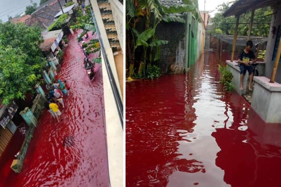 Surreale Szenen: Dorf wird von blutrotem Fluss überschwemmt