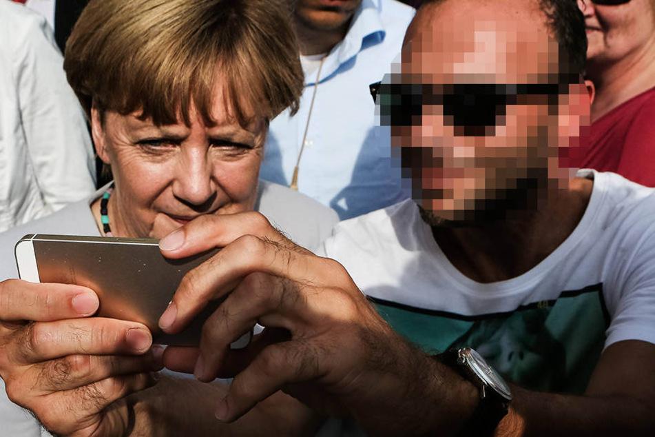 Der Mann ist auf einem Selfie mit Bundeskanzlerin Angela Merkel (62, CDU) zu sehen, das Unbekannte für Hetze in dem Netzwerk genutzt haben sollen. (Symbolbild)