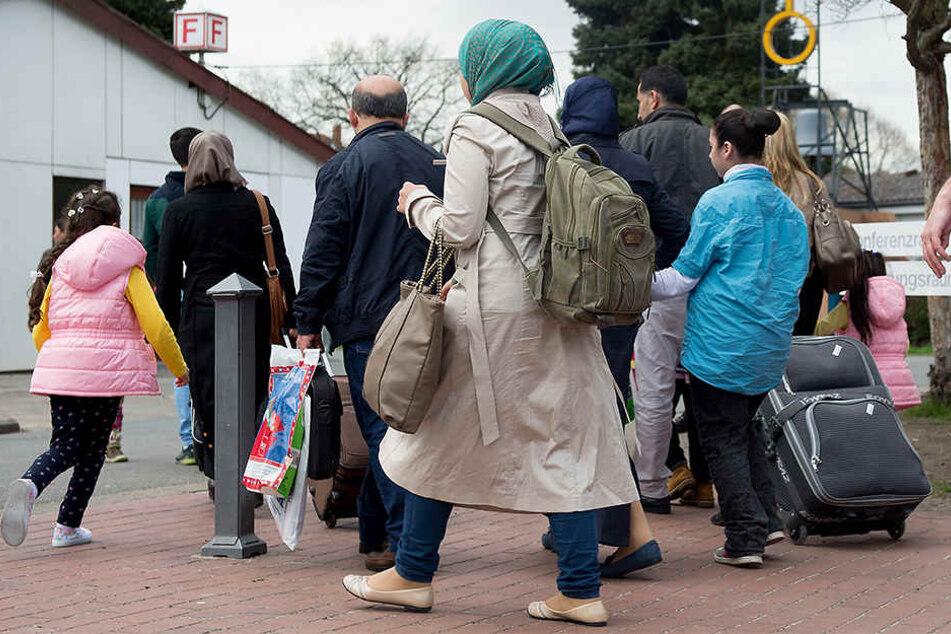 Syrische Flüchtlinge kommen in das Grenzdurchgangslager Friedland.