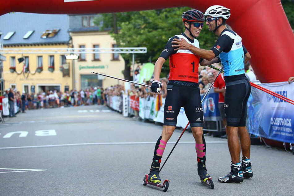 Die Fans hoffen auf eine Wiederholung: Im Vorjahr gewannen Eric Frenzel (l.) und Björn Kircheisen den Teamsprint in Oberwiesenthal.