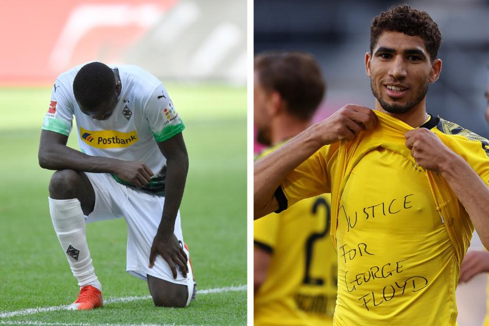 Links kniet Gladbachs Marcus Thuram, rechts Achraf Hakimi vom BVB. Auch er hatte einen Unterzieher, genau wie Jadon Sancho.